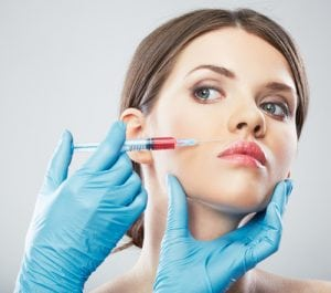 Woman Getting Facial Filler Injections