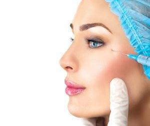 Beautiful woman gets beauty facial injections