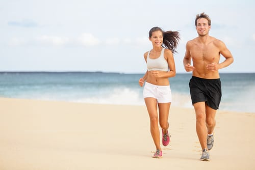 young couple running on beach-img-blog