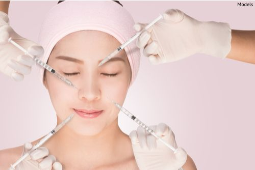 Woman having a rejuvenating injection procedure useful for smoothing skin